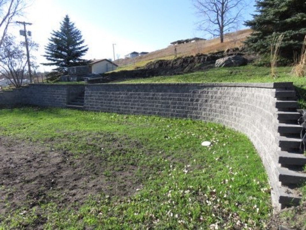 Talk to an experienced retaining wall builder about erosion control